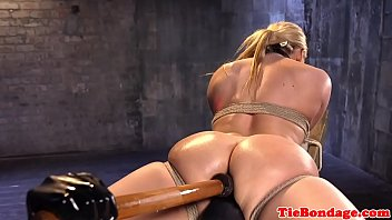 tied table on Husband fists wife